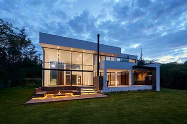 Spacious modern house, designed by architect, featuring outdoor entertainment spaces and multi-level floor to ceiling windows