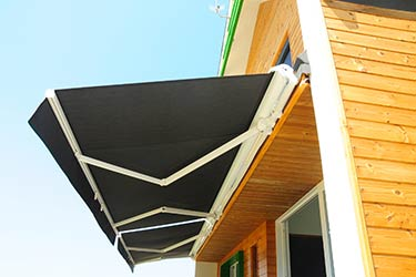 Modern, quality retractable patio awning on stylish house