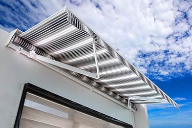 Contemporary, state of the art, retractable patio awning on trendy building