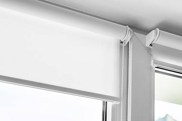 Close up of quality Roman blinds roller fixtures on modern window