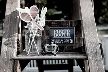 Charming, eclectic mobile photobooth set up at wedding with props