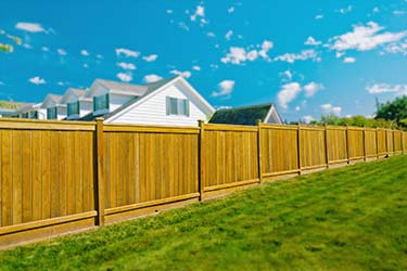 Warm toned shiplap timber boundary fencing