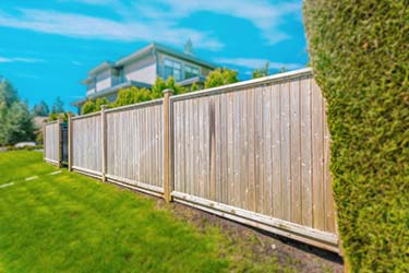 High quality timber shiplap boundary fence at luxury property