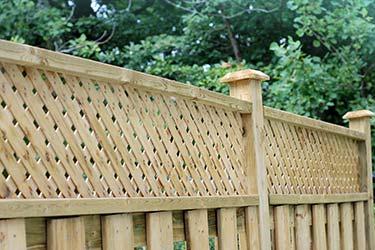 Close up of timber trellis top boundary fencing