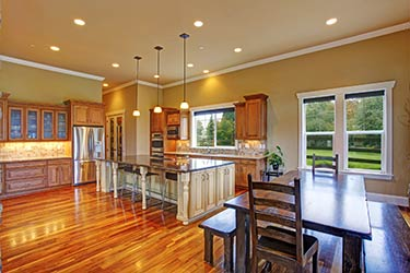 Stunning, classy kitchen and dining room with polished hardwood floors
