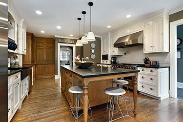 Distinguished, spacious kitchen with rustic hardwood flooring
