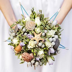 Beige flower bouquet decorated with shells