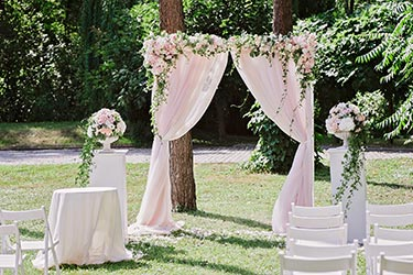 Ceremony arrangements with arch cloth and flowers