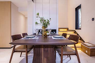 Beautiful custom made, matching dining table and chairs in stylish home