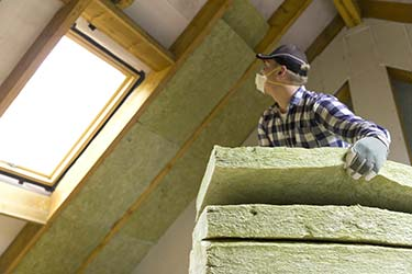 Professional installation of eco friendly insulation in ceiling around skylight
