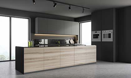 Dark, moody, minimalist kitchen with high end appliances