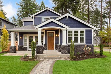Richly coloured exterior home paint job on beautiful classic house
