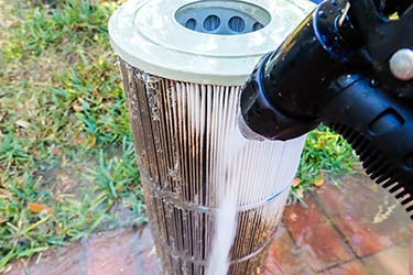 Pool cleaner professionally cleans pool water filter cartridge, ensuring pool water is safe for swimming