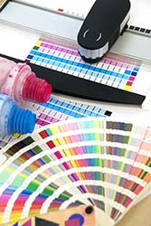 Printing supplies and Pantone swatchbook in preparation for large print job