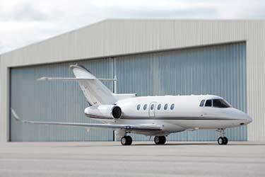 Midsize jet outside hanger