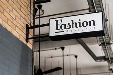 Stylish, 3D street sign for high-end designer fashion shop