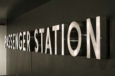 Modern 3D metal signage for public transport station
