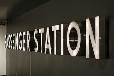 Modern 3D metal signage for public transport station