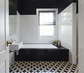 Attractive monochromatic floor tiling in stylish home