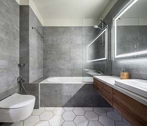 Clean and chic stone and porcelain tiling in modern bathroom
