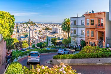 The famous, curly Lombard Street, where tourists flock for the interesting design, beautiful gardens, and fabulous Victorian mansions