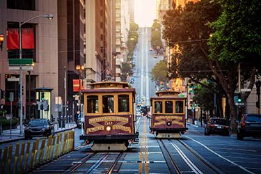 Historic Cable Cars travel along Powell and Market Street in downtown San Francisco, a favoured means of travel in the city centre for tourists