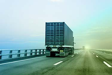 Secure transportation truck drives shipment to destination